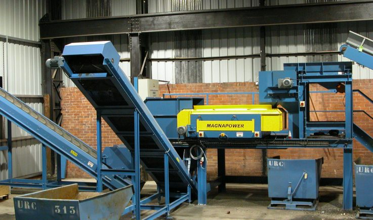 Drum magnet and eddy current separating metals from shredded electrical waste