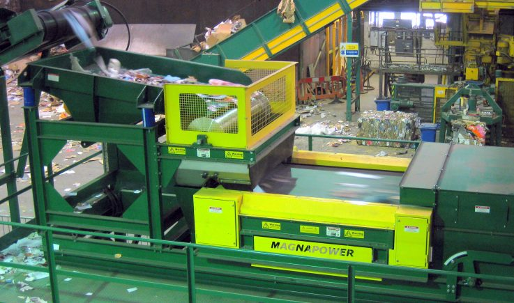 Eddy Current with drum magnet sorting cans from plastic bottles
