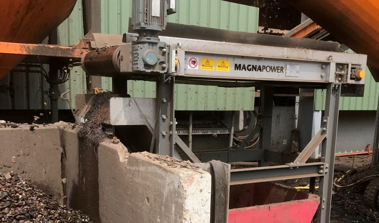 Magnetic pulley separating ferrous metal from recycled aggregate