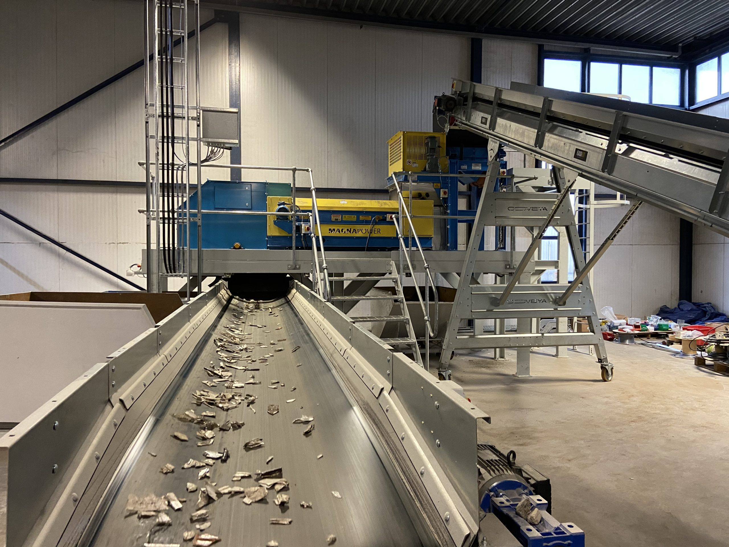 Metal free plastics after drum magnet and eddy current separate metals in window frame recycling plant