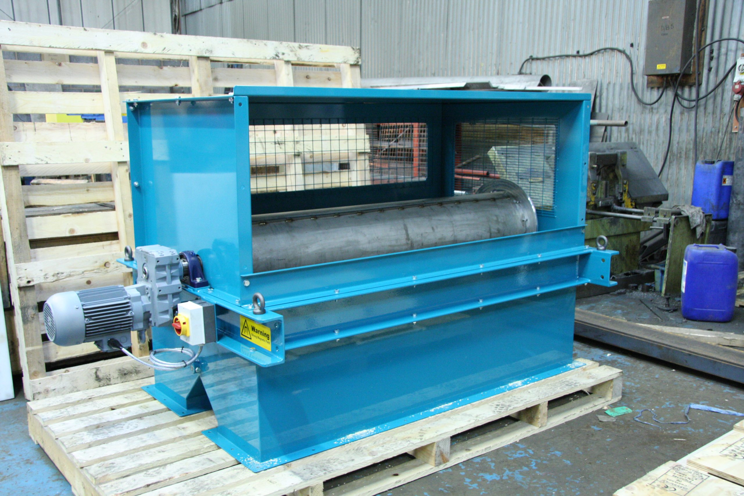 Drum magnet and guards for fitting at end of vibratory feeder
