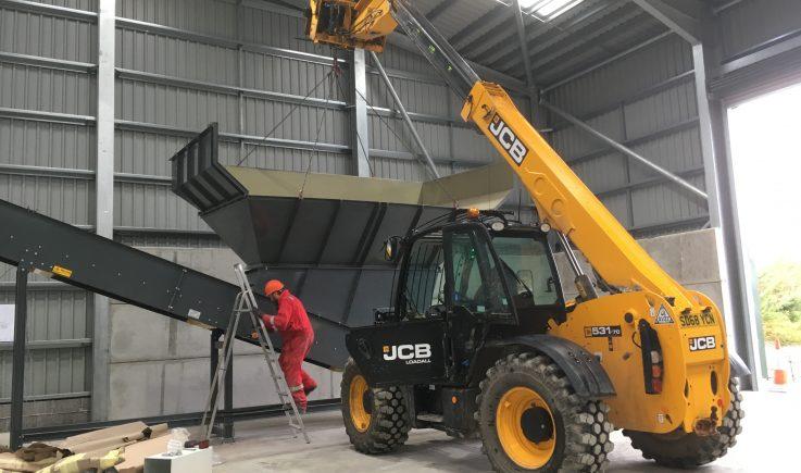 Installation of hopper onto conveyor